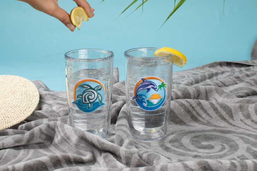 Recycled emblems on recycled plastic tumblers